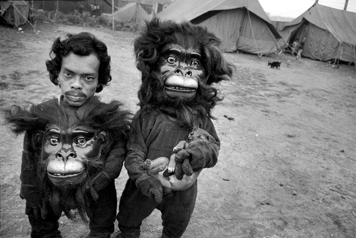 """Indian Circus 89. 401S-197-008 India 1989 Twin Brothers Tulsi and Basant, Great Famous Circus, Calcutta, India, 1989 Mary Ellen Mark: 25 Years. Bulfinch Press. Little Brown and Company 1991 ÒTwin Brothers Tulsi and Basant, Great Famous Circus, Calcutta, India, 1989Ó Indian Circus. Japan Independent Communications Corporation 1993 Indian Circus. Chronicle Books 1993 ÒTwin Brothers Tulsi and Basant. Famous Circus, Calcutta, 1989"""" Life. February 1991. pp. 53 ÒTwin Clowns. Brothers Tulsi and Basant, with pet puppy, of the Great Famous Circus. Photographed in Calcutta.Ó The Independent Magazine. 14 September 1991. pp. 36 and 37 ÒTulsi and Basant, brothers who are dwarfs and perform as clowns at the Great Famous Circus. Photographed in Calcutta.Ó Image. February 1991. pp. 62 Rolling Stone. October 3, 1991. pp. 50 ÒTwin brothers Tulsi and Basant, Great Famous Circus, Calcutta, India, 1989Ó Sunday Mid-Day. February 16, 1992. pp. XII-XIII ÒTwins Tulsi and Basant, Great Famous Circus, CalcuttaÓ WomenÕs Art Magazine. March/April 1992. pp. 6 ÒTwin Brothers Tulsi and Basant, Great Famous Circus, Calcutta, India, 1989.Ó Discovery. January 1992. pp. 86 & 87 ÒTwin brothers Tulsi and Basant: Great Famous Circus, Calcutta, India, 1989.Ó PhotoPro. Sept/Oct 1992. pp. 41 ÒTwin brothers Tulsi and Basant, Great Famous Circus, Calcutta, India 1989.Ó"""